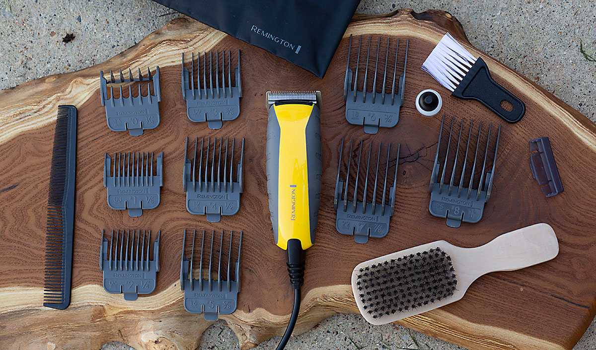 Cortadora de cabello indestructible a prueba de impactos sobre madera rodeada de 9 peines y 5 accesorios